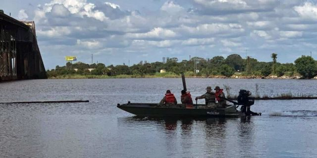 Guardsmen with 256th Infantry Brigade Combat Team conduct refresher boat training in Lake Charles, La., Aug. 25, ahead of Hurricane Laura's landfall in southwest Louisiana. (Photo by Louisiana National Guard)