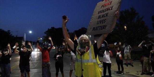People gather to protest Wednesday, Aug. 26, 2020, in Kenosha, Wis. (AP Photo/Morry Gash)
