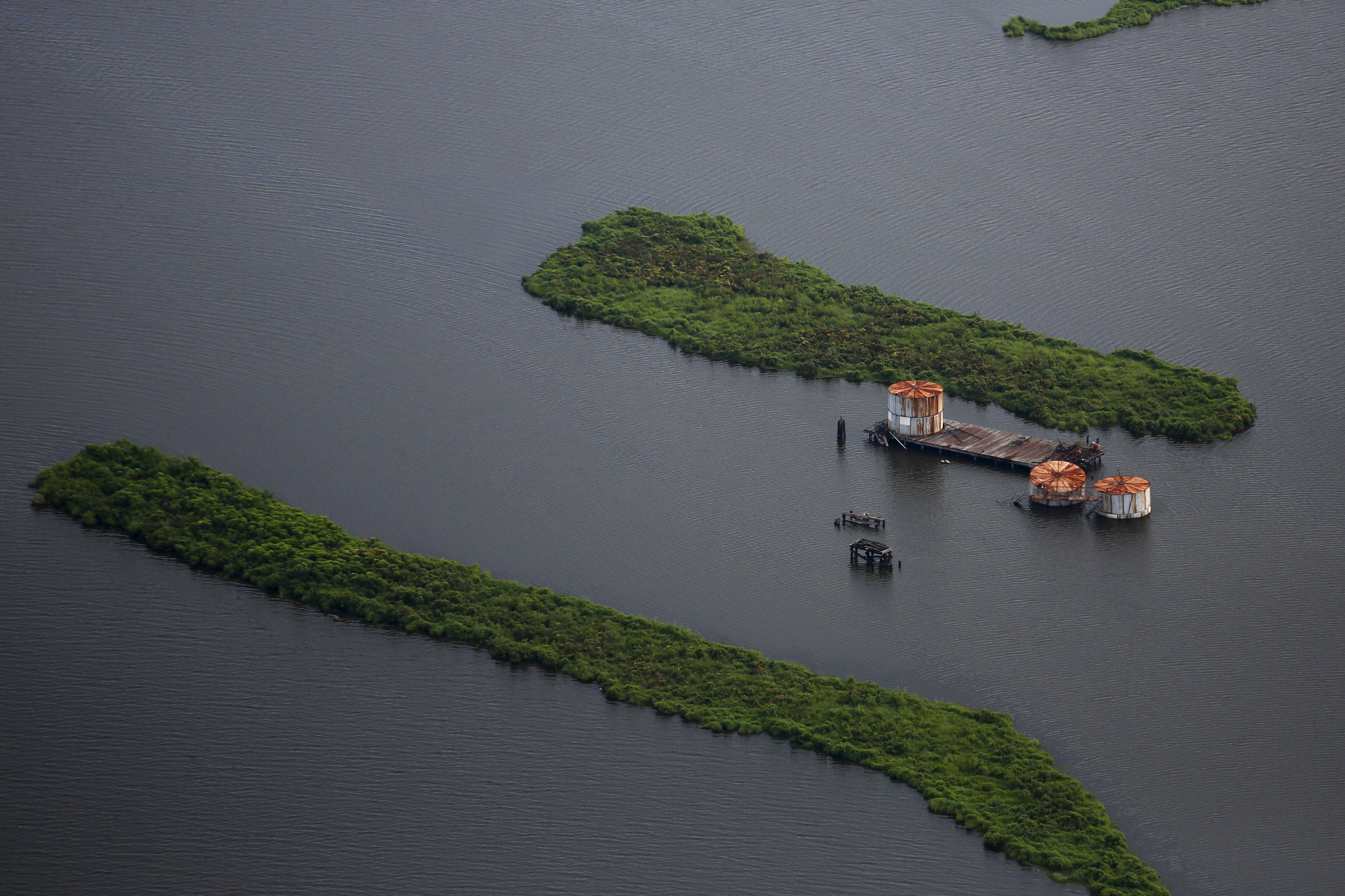Old oil tanks are seen in an area affected by Hurricane Katrina on the Mississippi River delta.