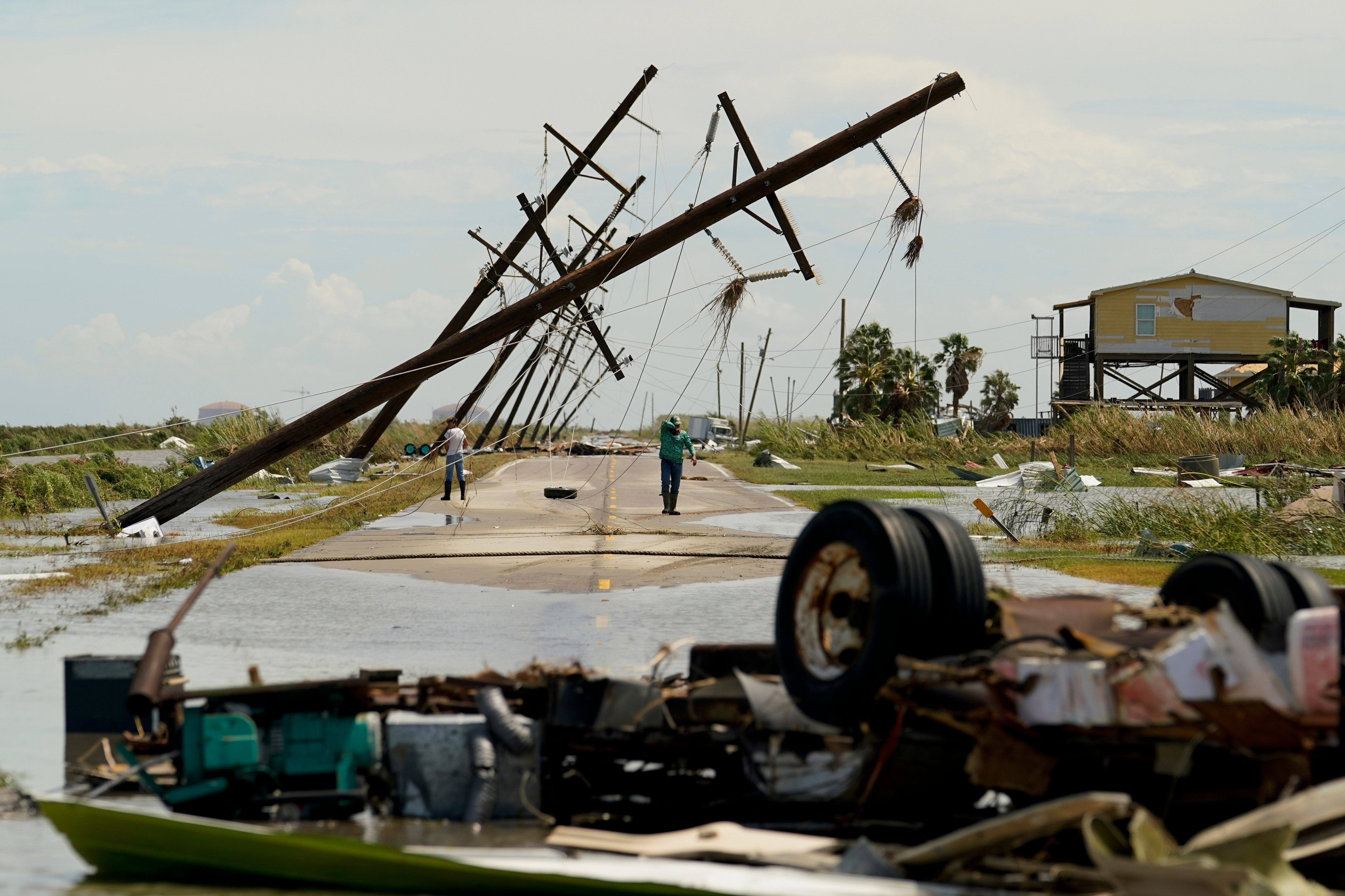People survey the damage left in the wake of Hurricane Laura on Thursday, Aug. 27, 2020, in Holly Beach, Louisiana.