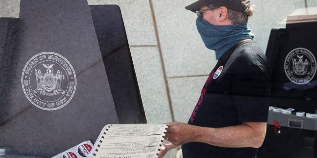 A voter casts a ballot at a polling station inside the Brooklyn Museum in New York in June 2020. (AP Photo/John Minchillo, File)
