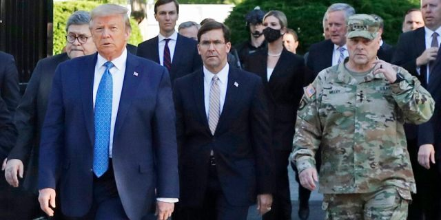 In this June 1 photo, President Trump departs the White House to visit outside St. John's Church, in Washington. Walking behind Trump from left are, Attorney General William Barr, Secretary of Defense Mark Esper and Gen. Mark Milley, chairman of the Joint Chiefs of Staff. (AP Photo/Patrick Semansky)