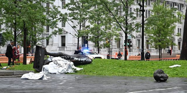 """A statue of the first Canadian Prime Minister John A. Macdonald lies on the ground (L), with the statue's head a few meters away, at Canada Park in central Montreal on August 29, 2020, after it was pulled down by anti-racism protesters during a demonstration calling for the defunding of the police. - Macdonald's government has been accused of seeking to assimilate indigenous peoples through forcible enrollment in residential schools, for example, that led to a loss of language and culture -- described in a 2015 reconciliation commission report as """"cultural genocide."""" (Photo by Eric THOMAS / AFP) (Photo by ERIC THOMAS/AFP via Getty Images)"""