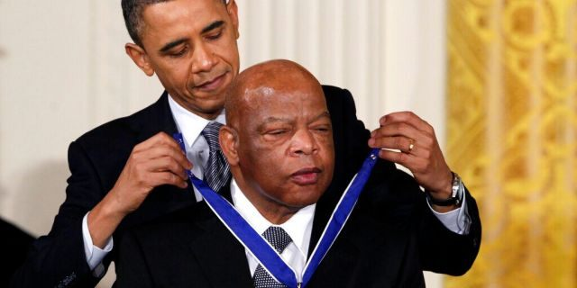 President Barack Obama presents a 2010 Presidential Medal of Freedom to U.S. Rep. John Lewis, D-Ga., during a ceremony in the East Room of the White House in Washington on Feb., 15, 2011. Lewis, who carried the struggle against racial discrimination from Southern battlegrounds of the 1960s to the halls of Congress, died Friday, July 17, 2020. (AP Photo/Carolyn Kaster, File)
