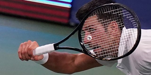 Novak Djokovic of Serbia returns a serve to Roberto Bautista Agut of Spain during the semifinals at the Western & Southern Open tennis tournament Friday, Aug. 28, 2020, in New York. (AP Photo/Frank Franklin II)