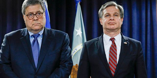 U.S. Attorney General William Barr and Wray stand together at an announcement of a Crime Reduction Initiative designed to reduce crime in Detroit on Dec. 18, 2019. (Photo by Bill Pugliano/Getty Images)
