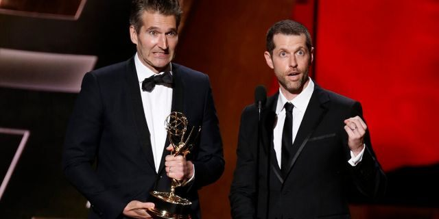 """David Benioff (L) and D.B. Weiss (R) accept the award for Outstanding Writing For A Drama Series for HBO's """"Game of Thrones"""" at the 67th Primetime Emmy Awards in Los Angeles, California September 20, 2015."""