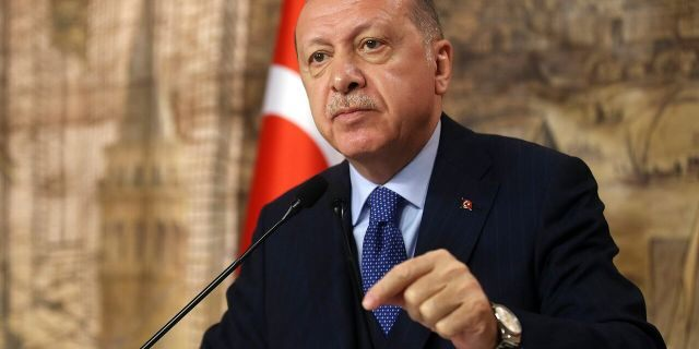 Turkey's President Recep Tayyip Erdogan speaks to his ruling party's lawmakers, in Istanbul, Saturday, Feb. 29, 2020. Erdogan said Saturday that his country's borders with Europe were open, as thousands of refugees gathered at the frontier with Greece.(Presidential Press Service via AP, Pool)
