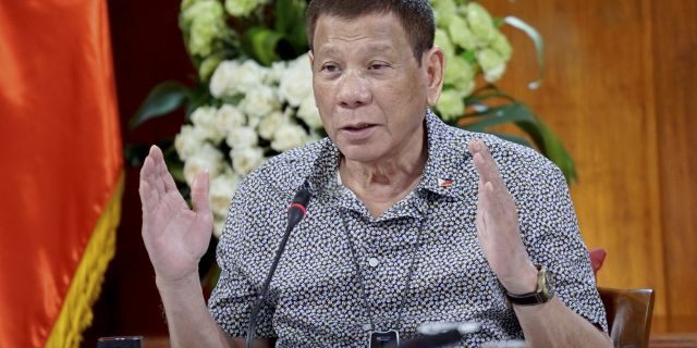 Philippine President Rodrigo Duterte gestures as he meets members of the Inter-Agency Task Force on the Emerging Infectious Diseases at the Malacanang presidential palace in Manila, Philippines on Monday. (AP/Malacanang Presidential Photographers Division)