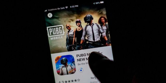 "A man looks at the ""PUBG Mobile"" game, owned by Chinese internet giant Tencent, in the App Store on an Apple iPhone in New Delhi on Sept. 2, 2020. (Jewel SAMAD / AFP) (Photo by JEWEL SAMAD/AFP via Getty Images)"