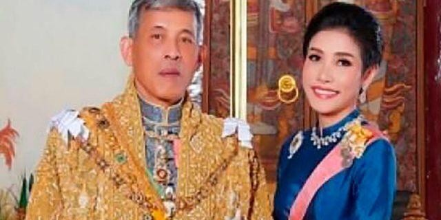 This undated file photo posted on Aug. 26, 2019, on the Thailand Royal Office website shows King Maha Vajiralongkorn, left, with Major General Sineenatra Wongvajirabhakdi, the royal noble consort. (Thailand Royal Office via AP, File)