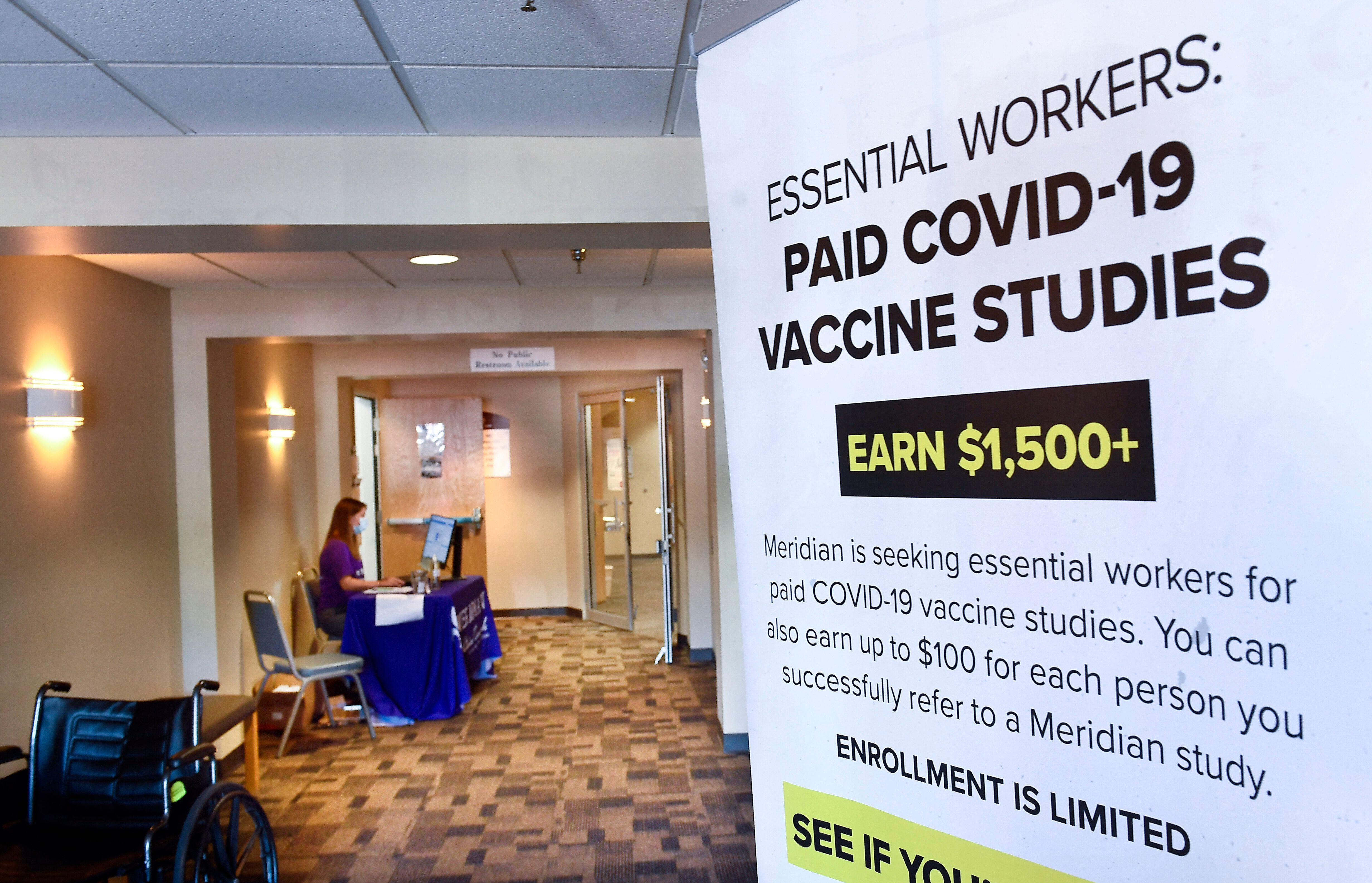 A poster seeking volunteers for a possible COVID-19 vaccine study in Binghamton, New York, in July. The FDA's commissioner ha