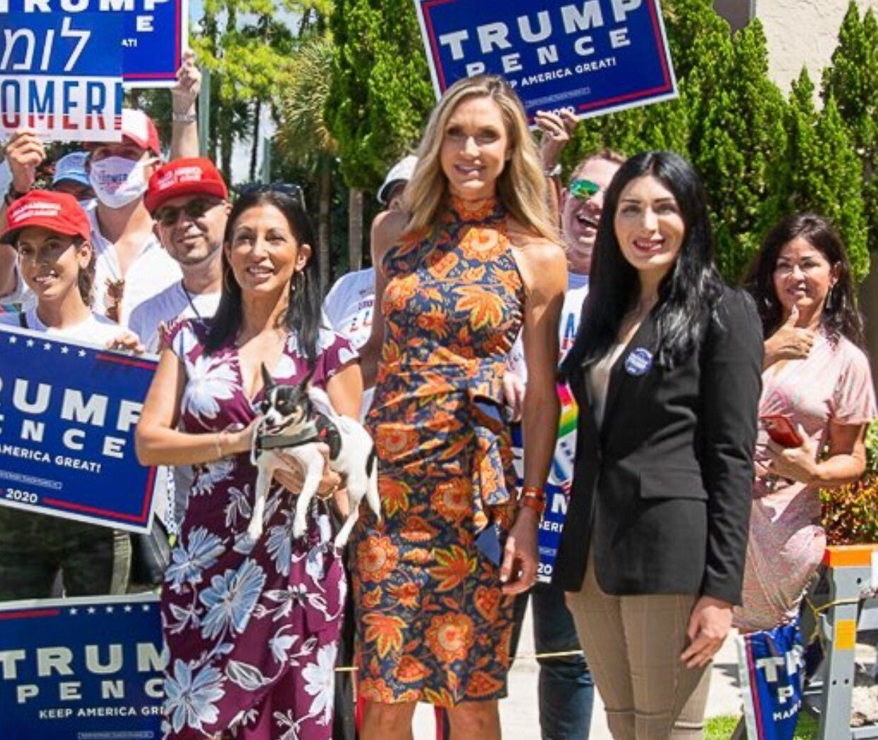 Lara Trump, center, an adviser to her father-in-law's presidential campaign, poses for a photo with Laura Loomer, right, one