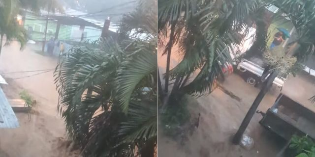 A flooded street and heavy rain in Coxen Hole, on the island of Roatan, Honduras, as Nana passed by on Wednesday.