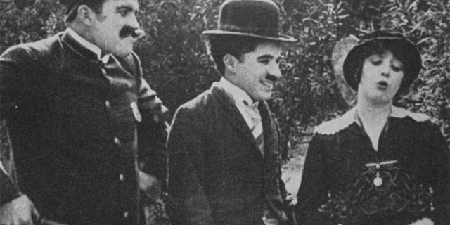Charlie Chaplin (center) with Mabel Normand in the 1914 film 'Getting Acquainted.'