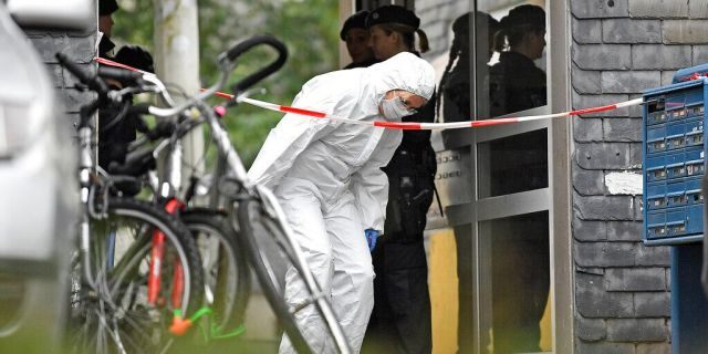 A forensic officer leaves a house, where five dead children were found in Solingen, Germany, Thursday, Sept. 3, 2020. Police say the five children have been found dead at an apartment in the western German city, and their mother is suspected of killing them. (AP Photo/Martin Meissner)
