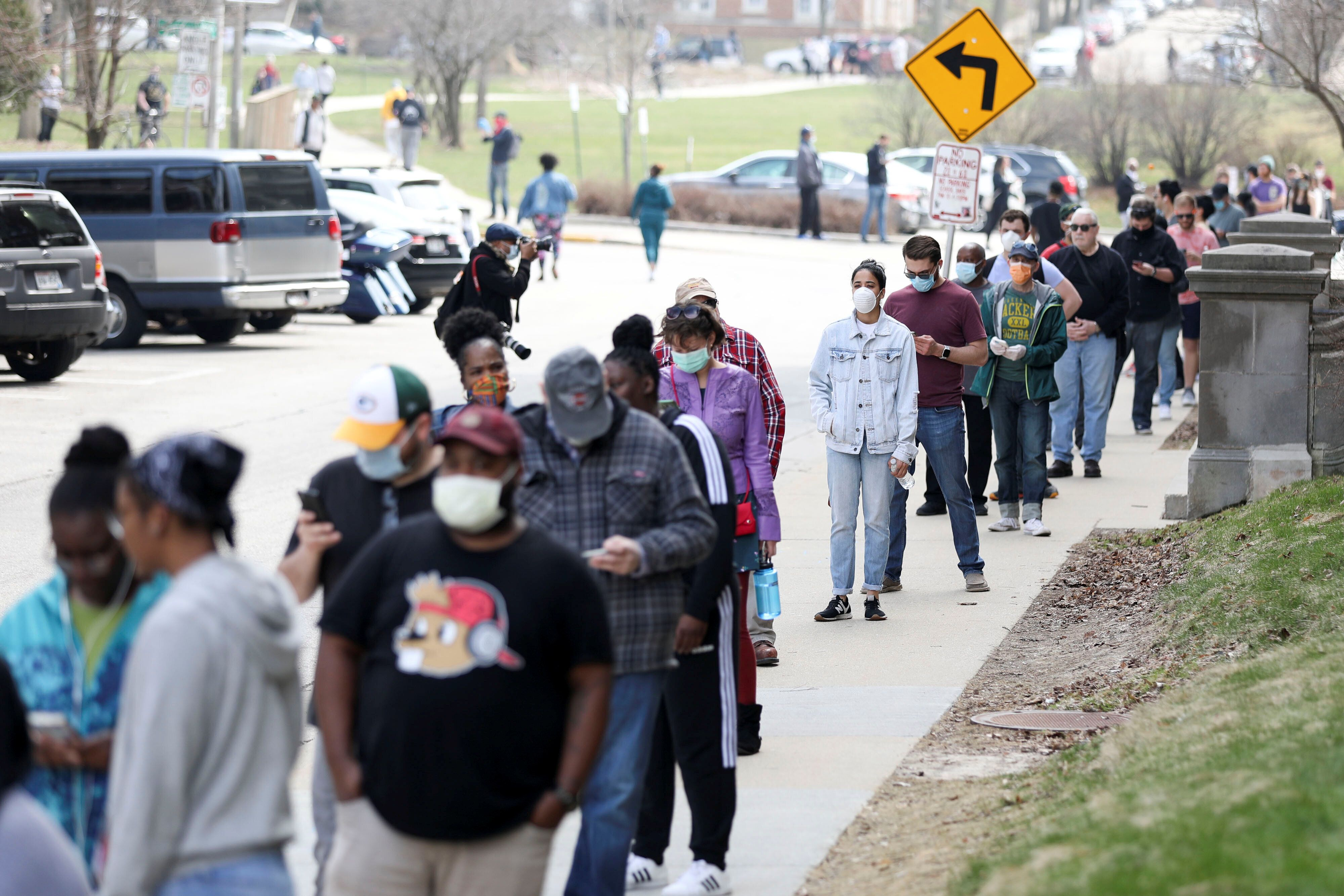 Voters waiting in line in Milwaukee for the primary on April 7. The state had trouble finding poll workers so had to consolid