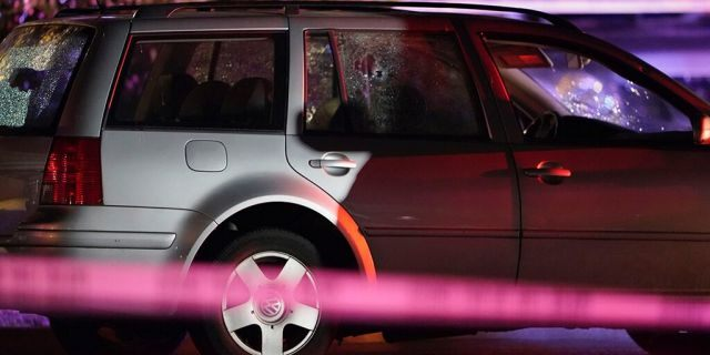A car with shattered windows and likely bullet holes stands in the area where a man suspected of fatally shooting a supporter of a right-wing group in Portland, Ore., last week was killed as investigators moved in to arrest him in Lacey, Wash., Thursday, Sept. 3, 2020. (Associated Press)