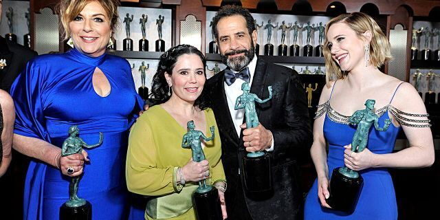 Caroline Aaron, Alex Borstein, Rachel Brosnahan, and Tony Shalhoub, winners of Outstanding Performance by an Ensemble in a Comedy Series for 'The Marvelous Mrs. Maisel', pose in the trophy room during the 26th Annual Screen ActorsGuild Awards at The Shrine Auditorium on January 19, 2020, in Los Angeles, California.