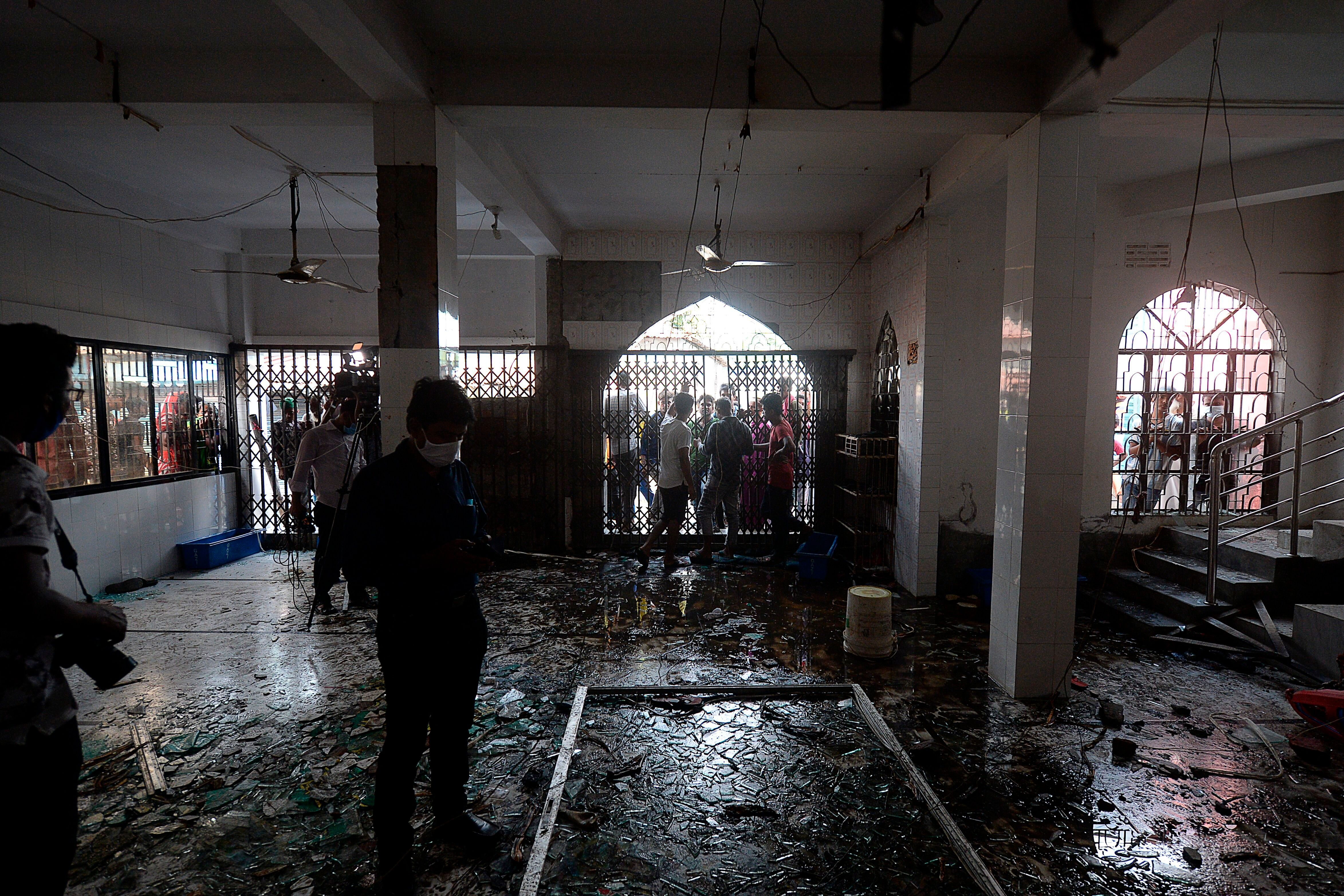 Shattered glasses are seen inside a mosque following a fire in the central district of Narayanganj, on September 5, 2020