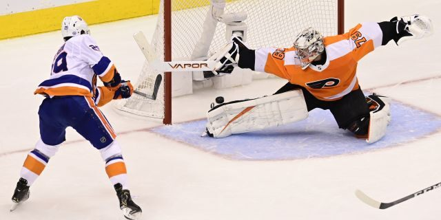 New York Islanders center Brock Nelson (29) scores against Philadelphia Flyers goaltender Carter Hart (79) during second-period NHL Stanley Cup Eastern Conference playoff hockey game action in Toronto, Saturday, Sept. 5, 2020. (Frank Gunn/The Canadian Press via AP)