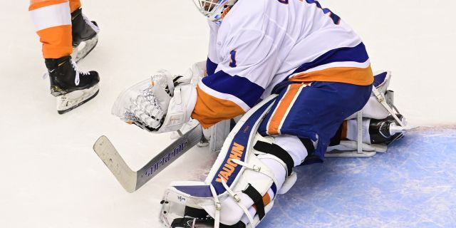 New York Islanders goaltender Thomas Greiss (1) makes a save against the Philadelphia Flyers during second-period NHL Stanley Cup Eastern Conference playoff hockey game action in Toronto, Saturday, Sept. 5, 2020. (Frank Gunn/The Canadian Press via AP)