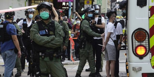 A man is arrested by police officers at a downtown street in Hong Kong Sunday, Sept. 6, 2020. About 30 people were arrested Sunday at protests against the government's decision to postpone elections for Hong Kong's legislature, police and a news report said. (AP Photo/Vincent Yu)