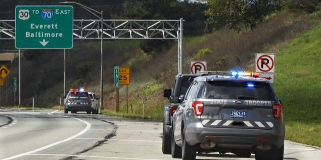 Pennsylvania State troopers pull over vehicles on Friday, Sept. 4, 2020, along the Pennsylvania Turnpike in Breezewood, Pa. Police around the country are reporting that as roads and highways emptied during the pandemic, some remaining drivers took advantage by pushing well past the speed limit. It's a trend that statistics show is continuing even as states reopen. (AP Photo/Keith Srakocic)