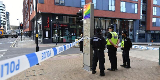 Police officers stand at a cordon in Hurst Street in Birmingham after a number of people were stabbed in the city centre on Sunday. (Jacob King/PA via AP)