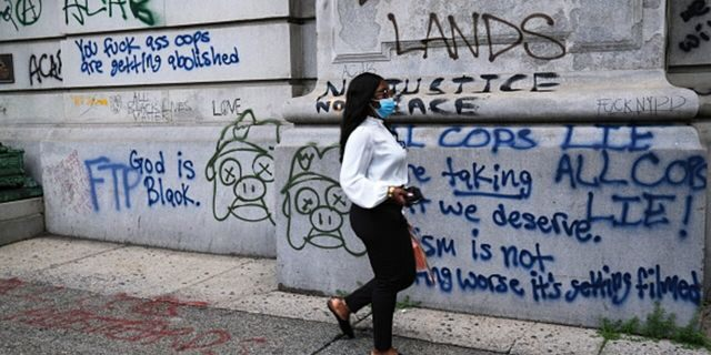 Newly painted graffiti marks a historic building near where protesters affiliated with Black Lives Matter and other groups have congregated in a park outside of City Hall in Lower Manhattan on June 30, 2020. (Photo by Spencer Platt/Getty Images)
