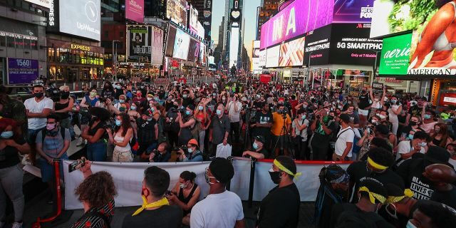 Black Lives Matter demonstrators gathered at Times Square to protest President Trump and Vice President Pence in New York City on September 4, 2020. (Photo by Tayfun Coskun/Anadolu Agency via Getty Images)
