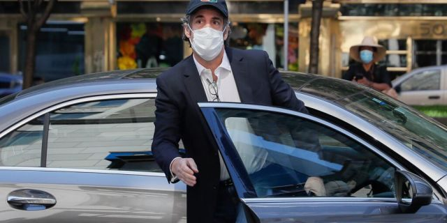 Michael Cohen arrives at his Manhattan apartment, May 21, 2020, in New York. (AP Photo/John Minchillo)