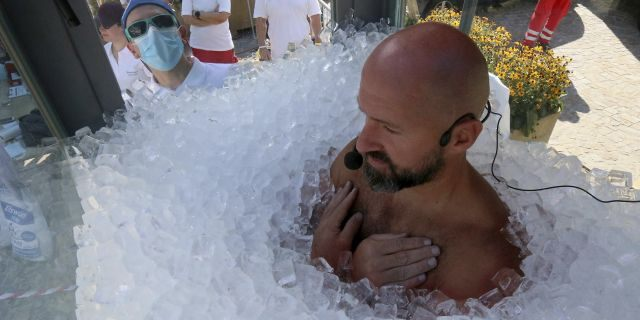 Austrian Josef Koeberl submerged himself in ice for 2.5 hours Saturday in Melk, Austria. (AP)