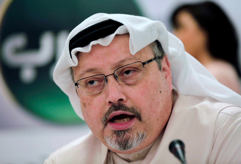 FILE - In this Dec. 15, 2014 file photo, Saudi journalist Jamal Khashoggi speaks during a press conference in Manama, Bahrain