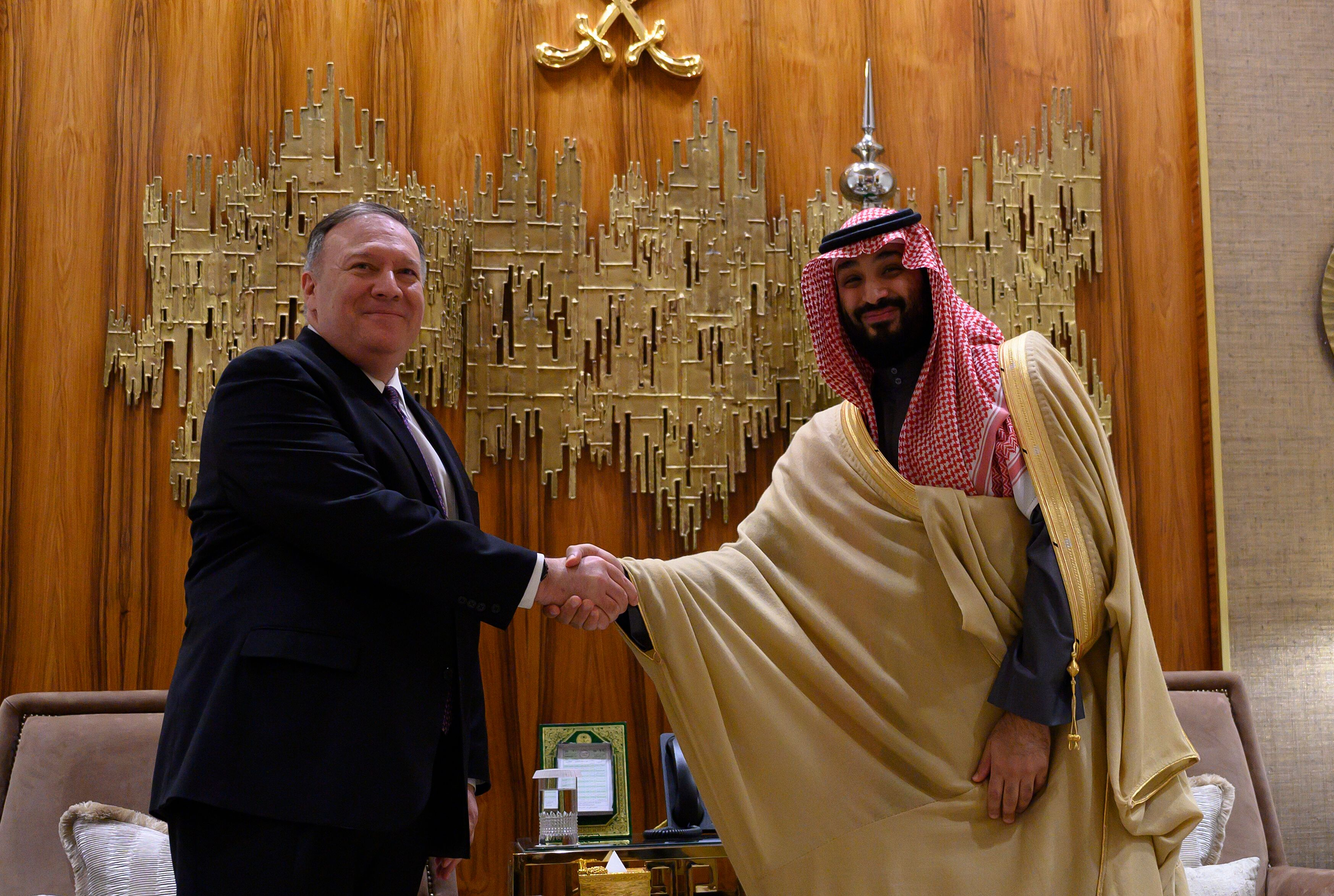 U.S. Secretary of State Mike Pompeo, left, shakes hands with Saudi Arabia's Crown Prince Mohammed bin Salman at Irqah Palace,