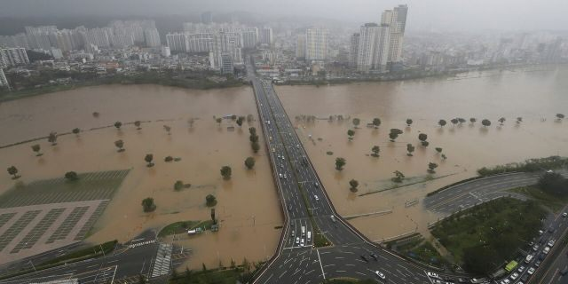 A part of a road and riverside near the Taehwa River are flooded due to heavy rain in Ulsan, South Korea, Monday, Sept. 7, 2020.