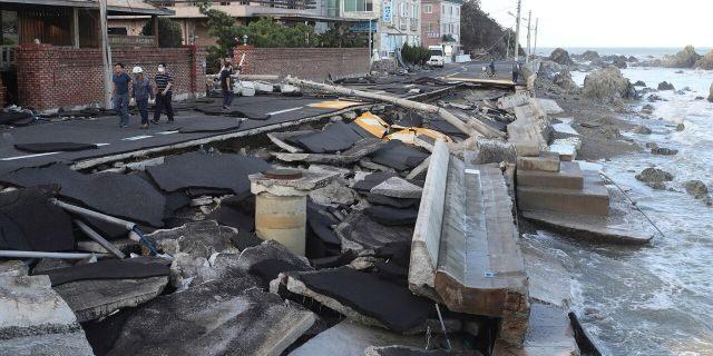 A coastal road is damaged in Ulsan, South Korea, Monday, Sept. 7, 2020.