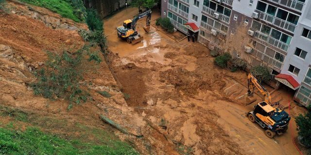 Mud from a landslide hit a parking lot at an apartment in Geoje, South Korea, Monday, Sept. 7, 2020.