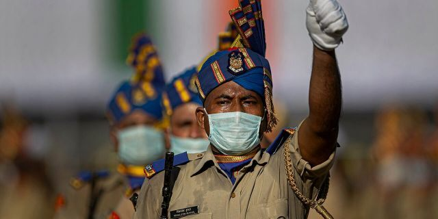 Indian paramilitary soldiers wearing face masks participate in the final dress rehearsals for India's Independence Day celebrations in Gauhati, India, Thursday, Aug. 13, 2020. (AP Photo/Anupam Nath)