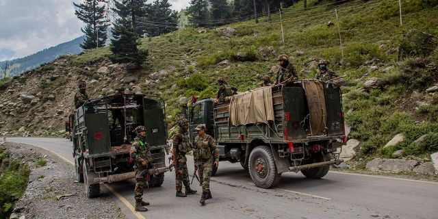 An Indian army convoy carrying reinforcements and supplies drives on a highway bordering China on Sept. 2 in Gagangir, India. (Getty Images)