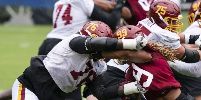 Washington offensive tackle Morgan Moses (76) blocks defensive end Chase Young (99) during an NFL football practice at FedEx Field, Monday, Aug. 31, 2020, in Washington. (AP Photo/Alex Brandon)