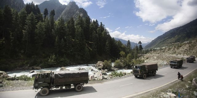In this Tuesday, Sept. 1, 2020, file photo, an Indian army convoy moves on the Srinagar- Ladakh highway at Gagangeer, northeast of Srinagar, Indian-controlled Kashmir. (AP Photo/Mukhtar Khan, File)