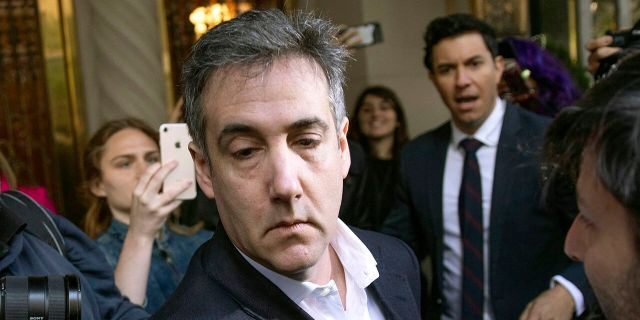 In this May 6, 2019, file photo, Michael Cohen, former attorney to President Donald Trump, leaves his apartment building before beginning his prison term in New York. Cohen is now serving his sentence at home, and released a tell-all book about his time as Trump's lawyer on Tuesday. (AP Photo/Kevin Hagen, File)