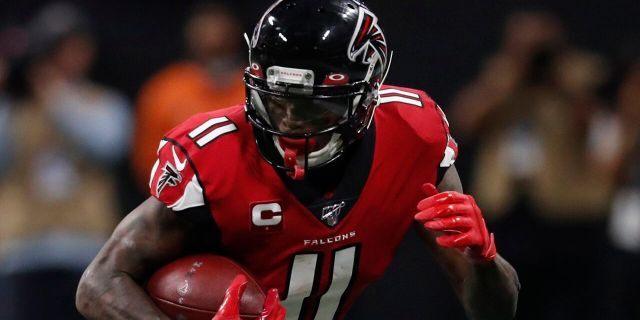 Atlanta Falcons wide receiver Julio Jones (11) runs by Jacksonville Jaguars cornerback A.J. Bouye (21) during the second half of an NFL football game, Sunday, Dec. 22, 2019, in Atlanta. (AP Photo/John Bazemore)