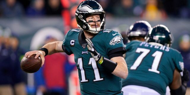 In this Jan. 5, 2020 photo, Philadelphia Eagles' Carson Wentz passes during the first half of an NFL wild-card playoff football game against the Seattle Seahawks in Philadelphia. Injuries forced Wentz to watch another quarterback lead the Eagles to their first Super Bowl title and put him on the sideline for playoff games in each of the next two seasons. (AP Photo/Chris Szagola, File)