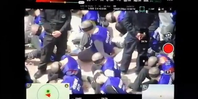 This screenshot purportedly shows hundreds of prisoners shackled and blindfolded who are believed to be from China's minority Uighur Muslims, reports claim.