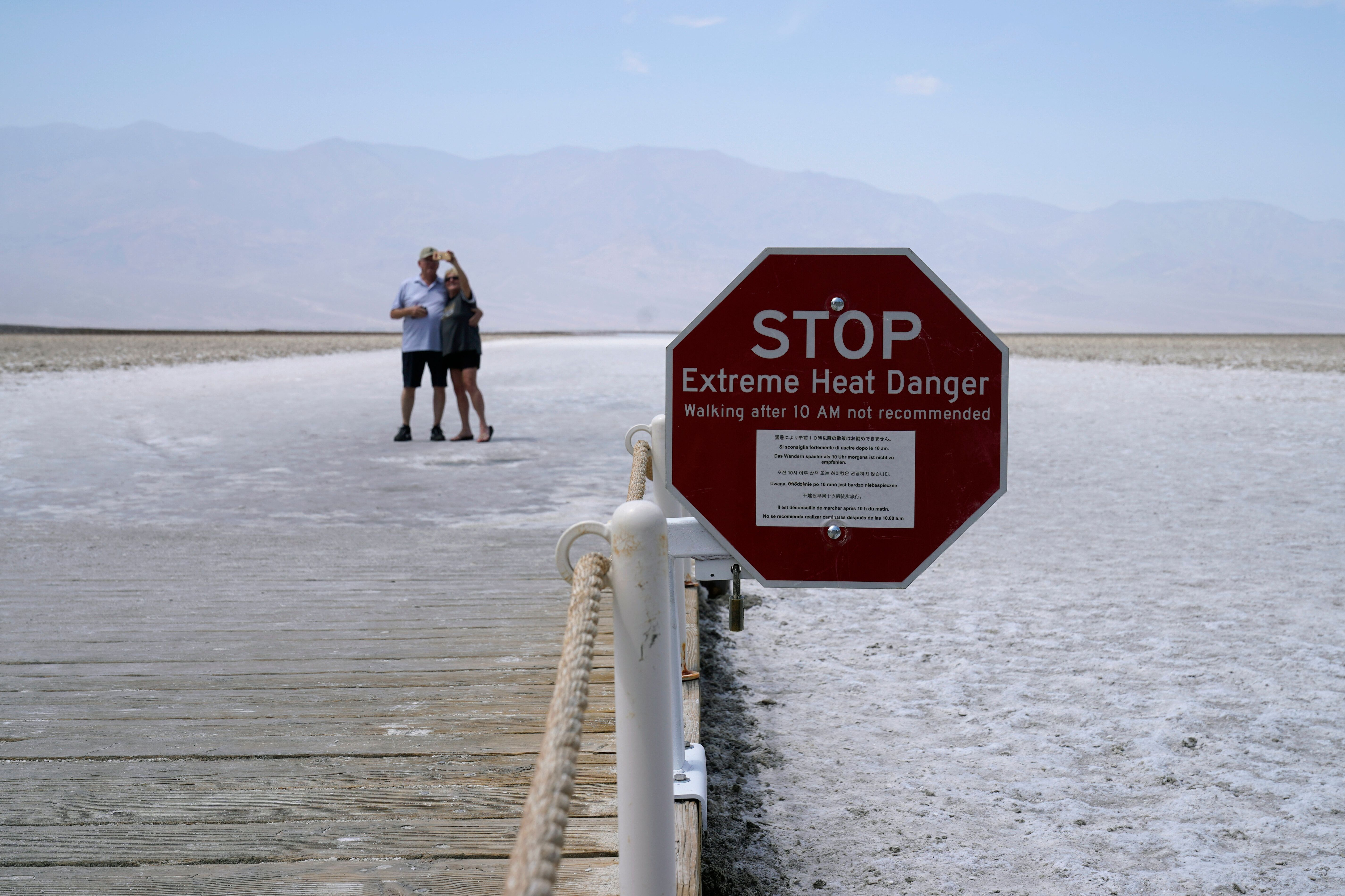 A sign warns of extreme heat danger at Badwater Basin, Monday, Aug. 17, 2020, in Death Valley National Park, Calif. (AP Photo