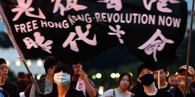 A demonstrator waves a flag during a rally to show support for Hong Kong pro-democracy protests at Free Square in Taipei on June 13, 2020. (Photo by Sam Yeh / AFP) (Photo by SAM YEH/AFP via Getty Images)