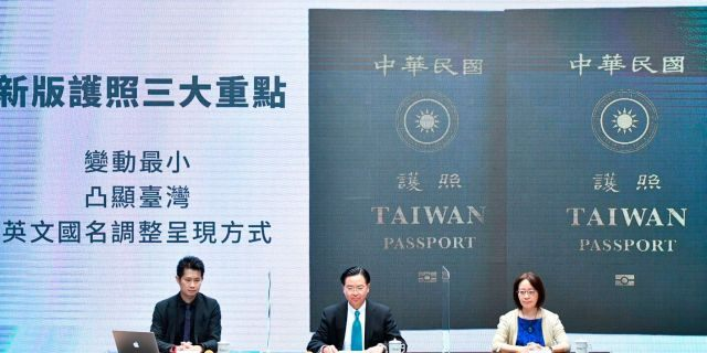 In this Sep. 2, 2020, photo released by the Executive Yuan, Taiwan's Foreign Minister Joseph Wu, center, and Executive Yuan spokesperson Evian Ting, left, and Director of Consular Affairs Bureau Phoebe Yeh attends a news conference to reveal the new Taiwan passport in Taipei, Taiwan. (Executive Yuan via AP)