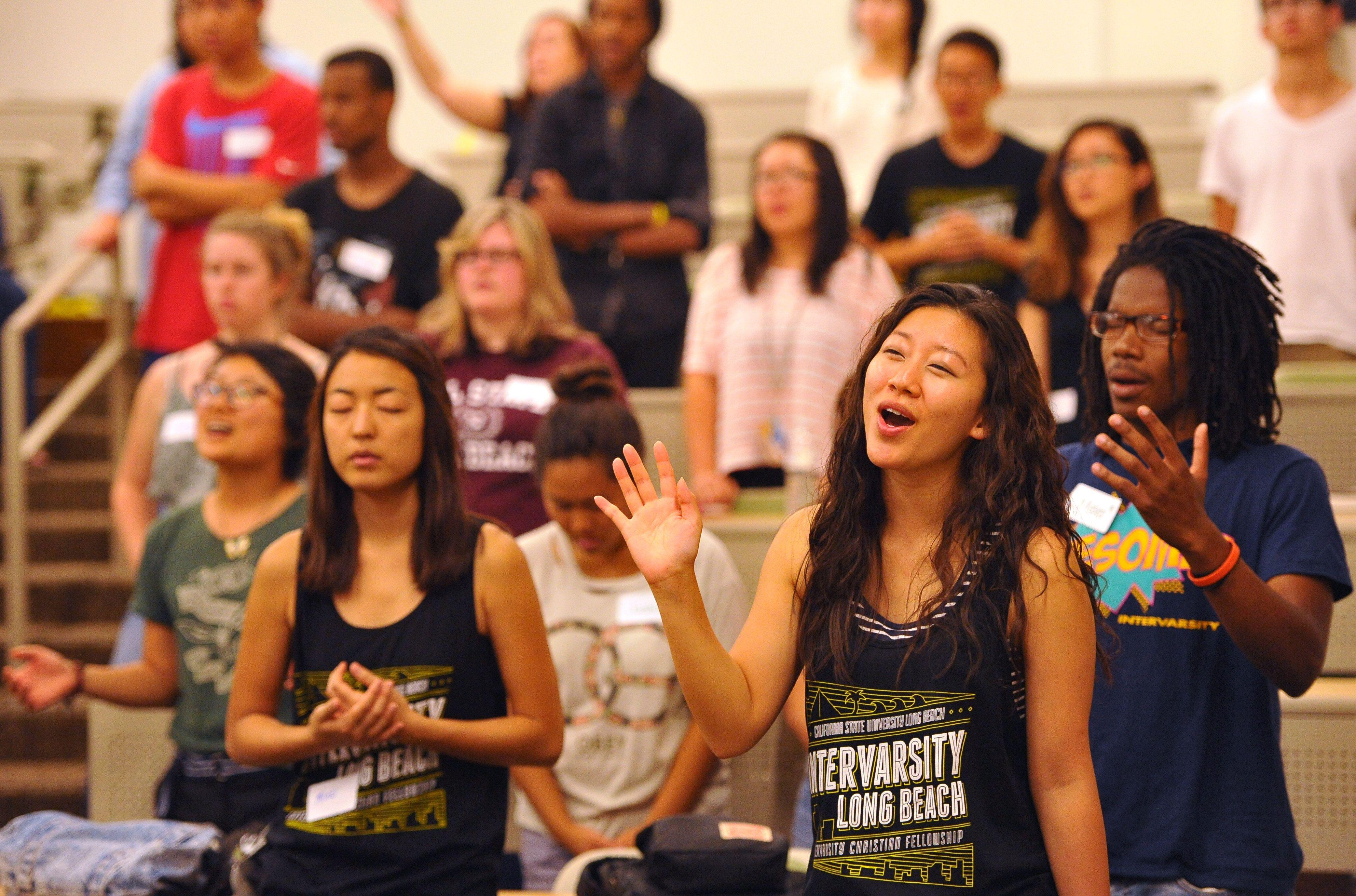 InterVarsity Christian Fellowship members worship during a weekly meeting at California State University Long Beach in Septem